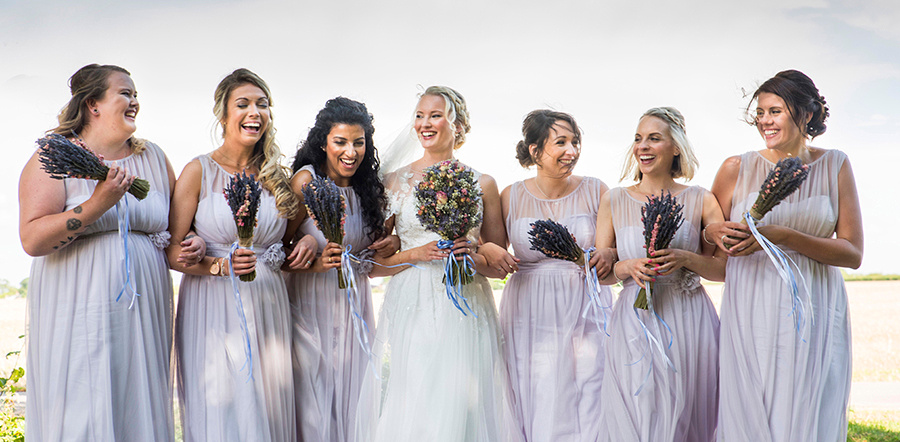 Bridesmaids laughing captured by a Bedford wedding photographer