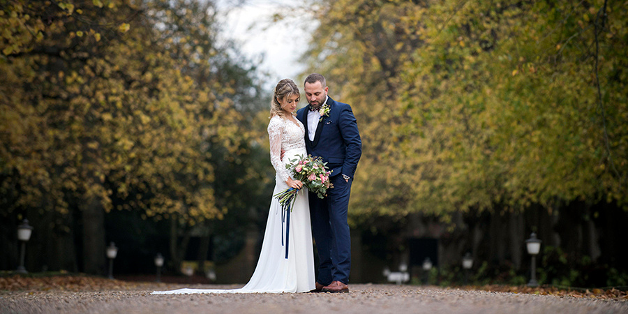 A couple in Autumn on their wedding day photographed by a wedding photographer from Bedford