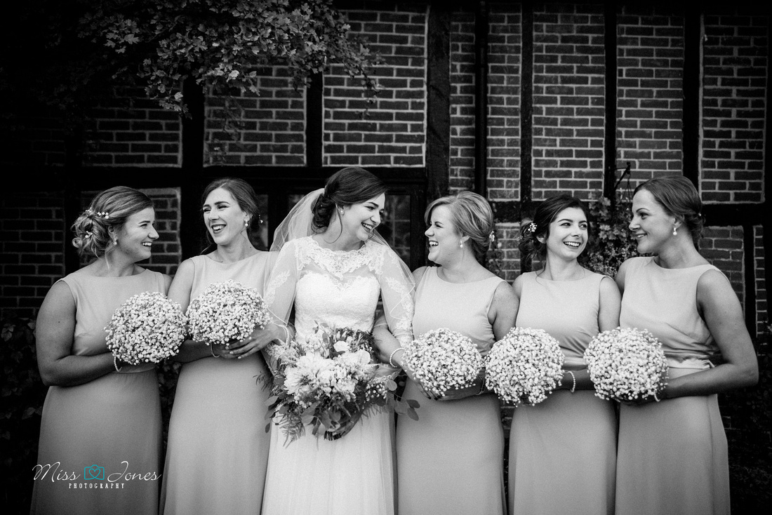 Barns Hotel wedding photograph of bridesmaids outside the Barns Hotel on a wedding day