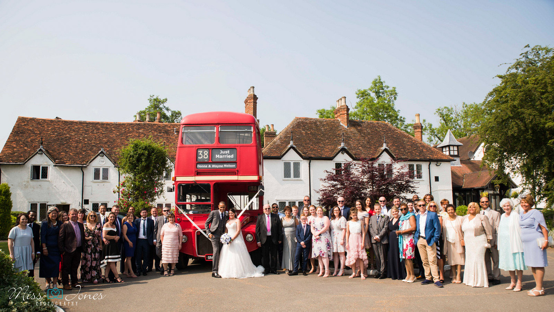 Barns Hotel wedding photograph of a red bus outside the Barns Hotel on a wedding day