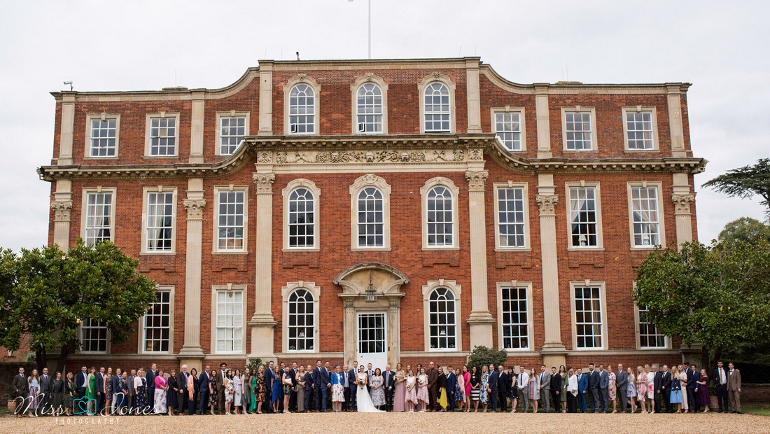 Wedding party outside Chicheley Hall