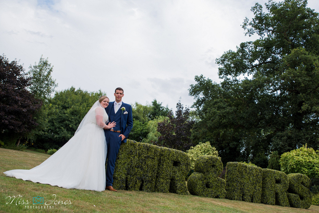 Mr & Mrs posing at the Stanwick Hotel