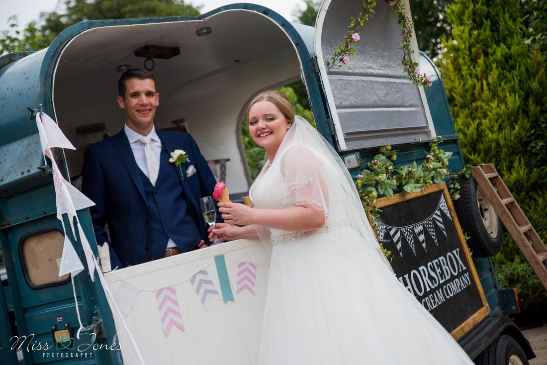 wedding couple posing at the horsebox icecream van