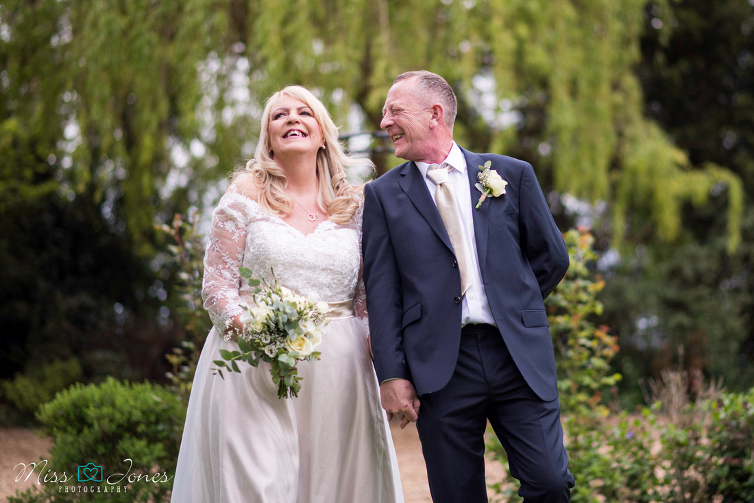 wedding couple smiling in the garden at Stanwick Hotel