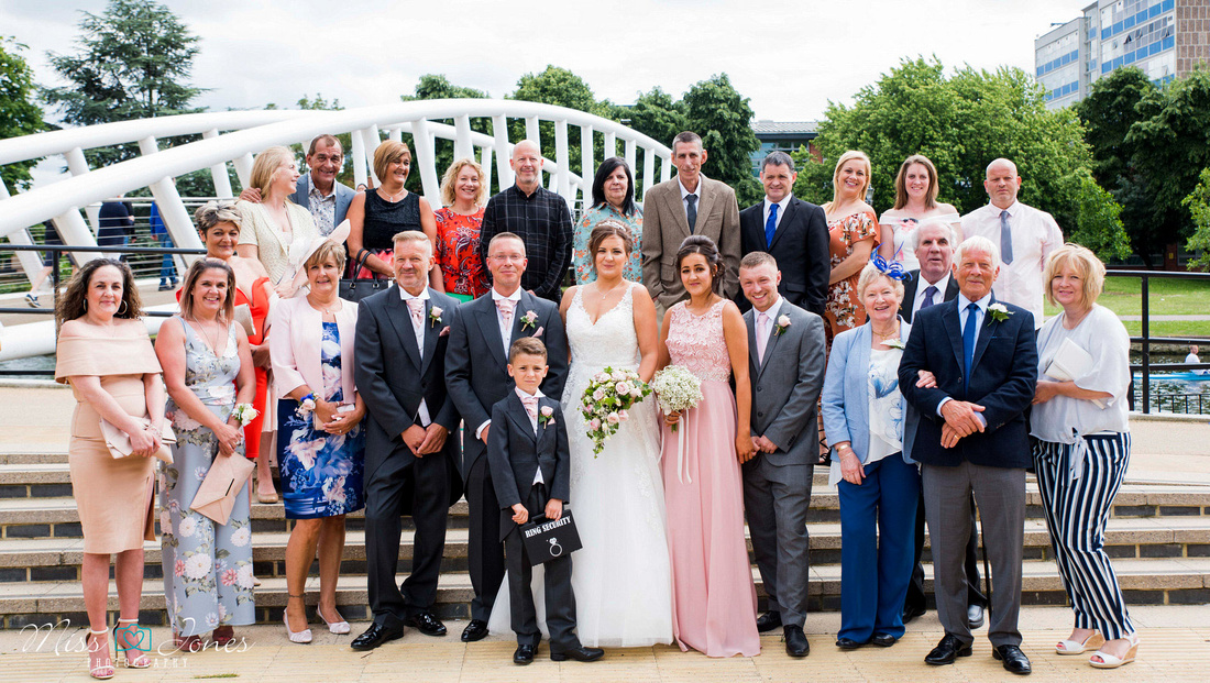 Wedding guests outside the Old Town Hall Bedford at the new bridge