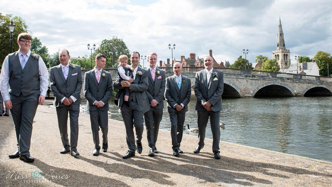 Groomsmen walking by Bedford town bridge wedding at the Mecure Hotel