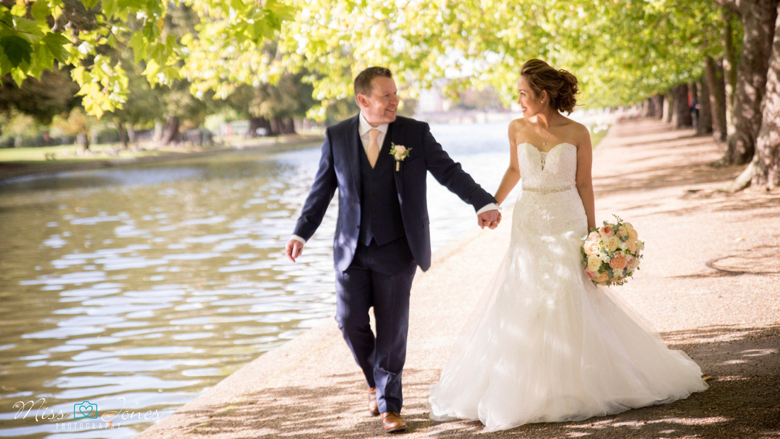 wedding couple walking along Bedford embankment after just getting married at Bedford Old Town Hall