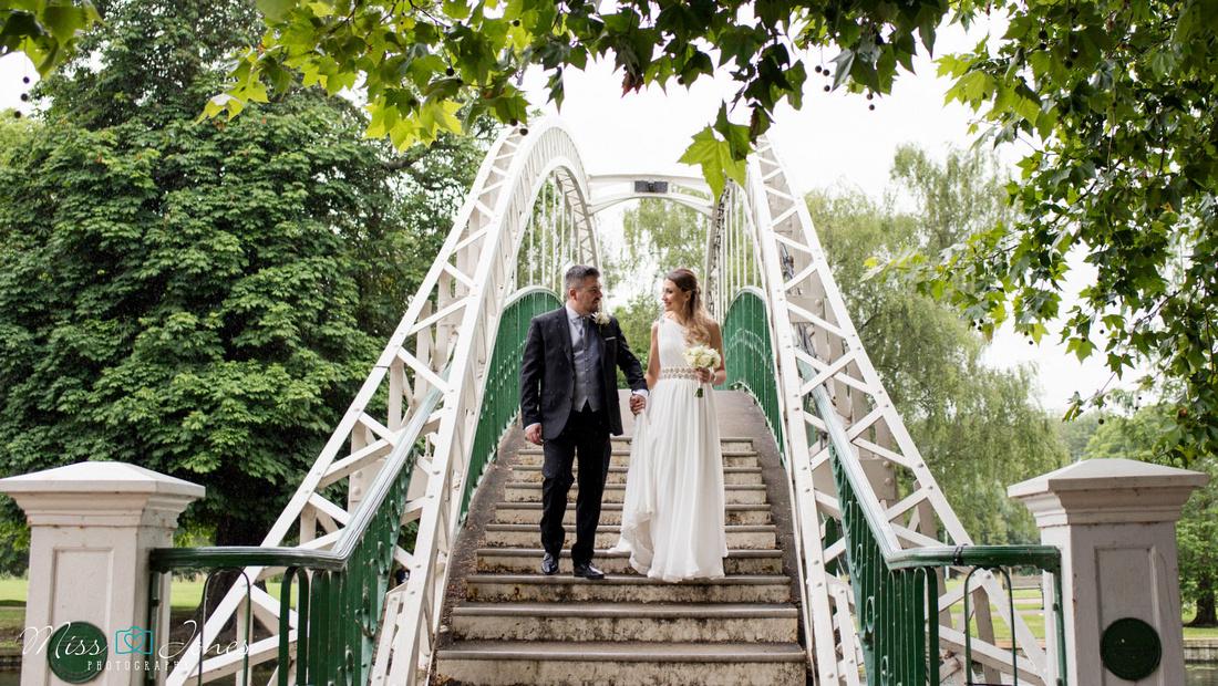Bedford wedding couple walking over the suspension bridge